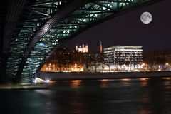 Lyon by night, on the Rhone bank. View of the Fourviere Basilica. Large full moon stock images