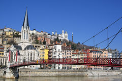 Lyon red footbridge and church Royalty Free Stock Photography