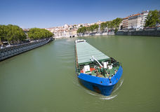 Lyon river. A barge moving along the river in Lyon, France Stock Photography