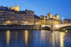 Lyon with Saone river at night Stock Photos