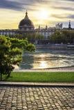 Lyon stad på solnedgången med Rhone River Royaltyfri Bild
