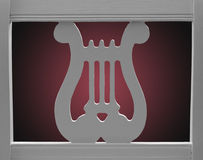 Lyre Chair. Back of wooden, straight chair with lyre design, backlit, gradient background Royalty Free Stock Photography