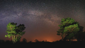 Lyrical night scene with bright Milky Way Stock Photo