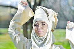 Lyrical woman against tree trunks in ethnic costume Royalty Free Stock Photo