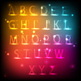 Lysande alfabet Neonengelskastilsort Arkivbilder