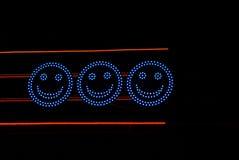 Lysande blåa elkraftcirklar med ögon och leenden Royaltyfria Foton