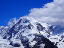Lyskamm at Monte Rosa massif, landscape of swiss alpine mountain range glacier in Alps, SWITZERLAND. From Gornergrat near Zermatt village, cloudy blue sky in Stock Image