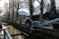 Snow covered water mill in the center of Lyss, Switzerland stock image
