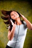 Lyssna till musiken Arkivbild