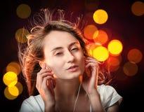 Lyssna till musiken Arkivfoto