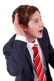 lyssnande barn för affärsman Arkivbild