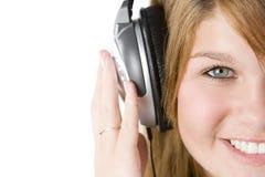 lyssnande musik för flicka som är tonårs- till fotografering för bildbyråer