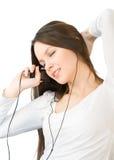 lyssnande musik för flicka till barn Royaltyfria Foton