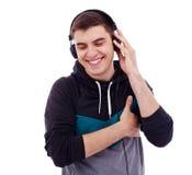 Lyssnande musik för grabb Arkivbilder