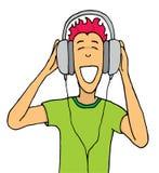 Lyssnande musik för grabb på enorm hörlurar Arkivfoton