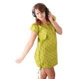 lyssnande musik för härlig flicka som är tonårs- till Arkivfoton