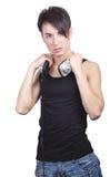 Lyssnande musik för ung man Arkivbilder