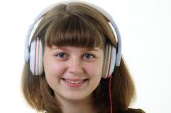 lyssnande musikbarn för flicka Arkivfoto