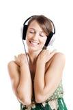 lyssnar musik royaltyfria bilder