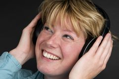 lyssnar musik till Arkivbilder