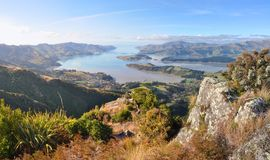 Lyttelton Harbour Panorama, Christchurch,  New Zealand. A panoramic view of Lyttelton Harbour at low tide from the top of the Christchurch Port Hills Royalty Free Stock Photo