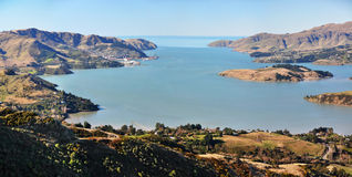 Lyttleton Harbour Panorama, New Zealand. A natural harbour formed when a volcano erupted, blew its top and the Pacific Ocean poured in.  The port of Lyttleton is Royalty Free Stock Photo