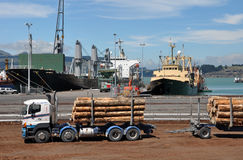 Lyttleton Logging Truck, Christchurch New Zealand. Lyttleton is the port of Christchurch. In the foreground is a logging truck and trailer offloading it's cargo Stock Images