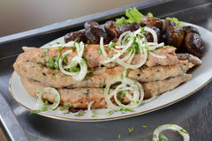 Lyulya-kebab and fried mushrooms Stock Photos