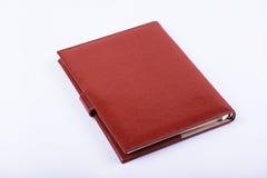 Lyxig dagbok för läder på vit bakgrund Arkivbild