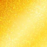 Lyxig guld- bakgrund med defocused bokeh Arkivbild