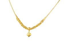 lyxig guld- halsband med hängen i hjärtaform royaltyfria bilder