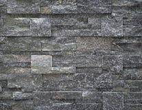 Lyxig innerväggcladding som göras av mörker - grå naturlig sten arkivbilder