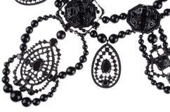 Lyxig modehalsband på svart bakgrund arkivbilder