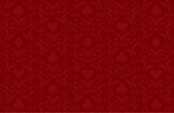 Lyxig röd pokerbakgrund med kortsymboler Arkivfoton