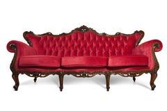 lyxig röd sofa fotografering för bildbyråer