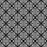 Lyxig sömlös modell Vit utsmyckad damast prydnad på en svart bakgrund Elegant tracery från virvlar och lövverk royaltyfri illustrationer