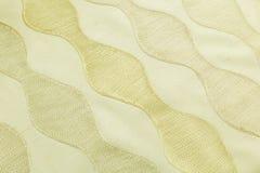 Lyxig torkduk för gul bakgrund eller krabba veck av för textursatäng för grunge siden- sammet Royaltyfria Foton