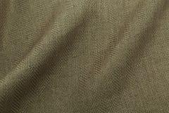 Lyxig torkduk för kaki- bakgrund eller krabba veck av för textursatäng för grunge siden- sammet Fotografering för Bildbyråer
