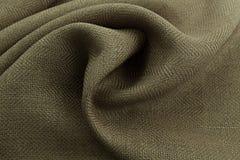Lyxig torkduk för kaki- bakgrund eller krabba veck av för textursatäng för grunge siden- sammet Arkivfoton