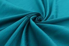 Lyxig torkduk för turkosbakgrund eller krabba veck av siden- textursatäng för grunge Arkivbilder