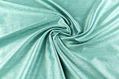 Lyxig torkduk för turkosbakgrund eller krabba veck av siden- textursatäng för grunge Fotografering för Bildbyråer