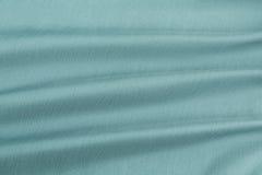 Lyxig torkduk för turkosbakgrund eller krabba veck av siden- textursatäng för grunge Royaltyfri Foto