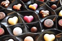 Lyxiga choklader, färgglad godis Arkivbild