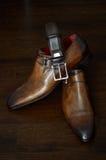 Lyxiga läderskor och bälte Royaltyfri Foto