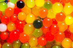 Mágica que cresce bolas coloridas da geleia Imagem de Stock Royalty Free