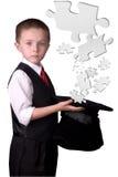 Mágico da criança com torta do enigma Imagem de Stock Royalty Free