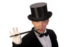 Mágico novo que executa com a varinha Fotografia de Stock
