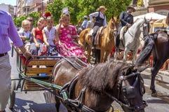 MÁLAGA, ESPAÑA - AGOSTO, 14: Jinetes y carros en la Málaga Imagen de archivo