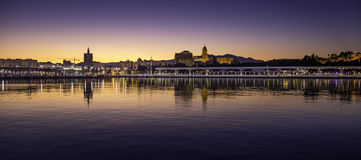 Málaga sunset. Photography of a sunset in Málaga port with view of Palmeral de las Sorpresas promenade and city center Royalty Free Stock Photography