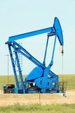 Máquina bruta da extração de Texas Oil Pump Jack Fracking fotografia de stock royalty free